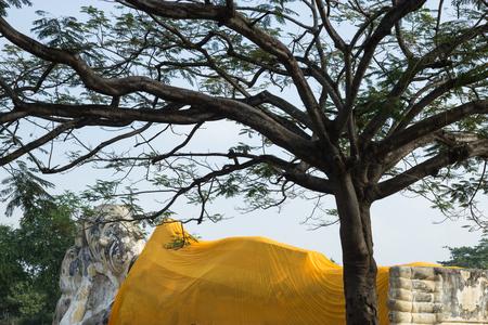 reclining: Reclining Buddha at Wat Lokayasutharam in Ayutthaya Thailand Stock Photo