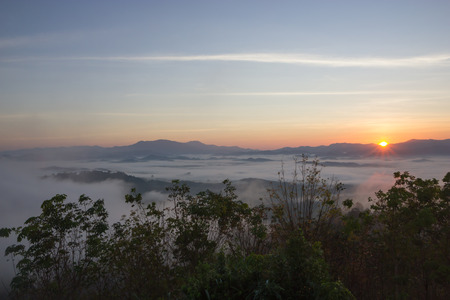 phangnga: The sun rises in the mist at Khao Kai Nui, Phangnga Thailand