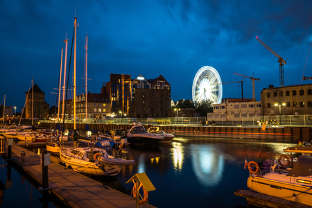 Marina and ferris wheel at night in Gdansk, Pomorze, Poland