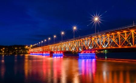 Bridge over Vistula river at night in Plock, Poland Stok Fotoğraf