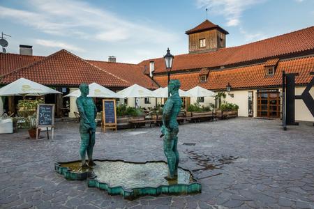 Prague, Czech Republic - 08 July 2017 - Sculpture of two pissing men and Franz Kafka museum in Prague