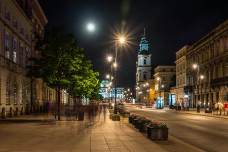 Church of the Holy Cross on Krakowskie Przedmiescie street at night in Warsaw, Poland