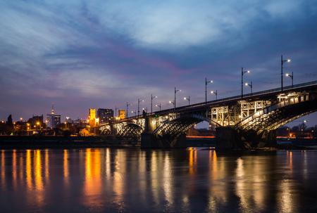 Poniatowski bridge over the Vistula river at night in Warsaw, Poland