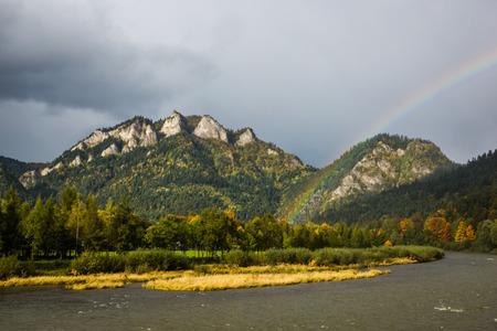 Rainbow over Three Crowns peak in Pieniny mountains at autumn, Poland