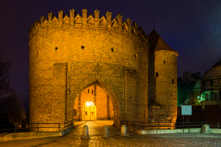 Night view at Barbican fortress (castle) in old town Warsaw, Poland