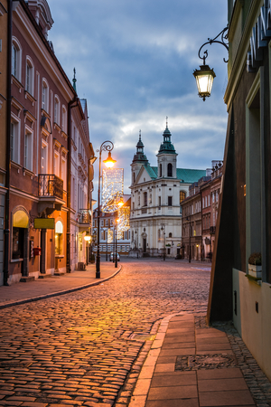 Pauline church of St. Spirit and Freta street at night on the old town in Warsaw, Poland Editorial
