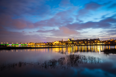 Night view on the old town and Vistula river in Warsaw, Poland