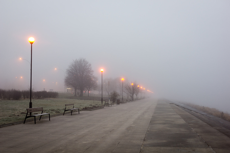 Boulevard on the Vistula river at foggy morning in Warsaw, Poland