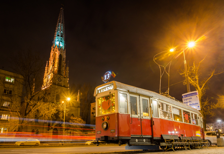 Church Evangelical Reformed and historic tram at Solidarnosci street in Warsaw, Poland