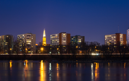 Night view on the Praga district and Vistula river in Warsaw, Poland