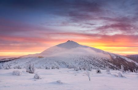Winter dawn over the Sniezka mount in the Giant Mountains, Karkonosze, Poland