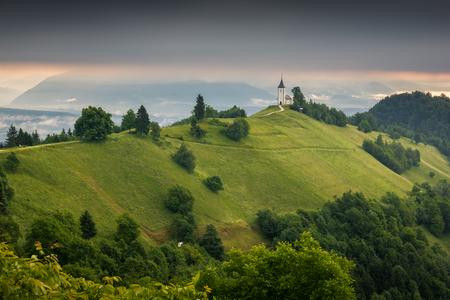 Church of St. Primus and Felician in Jamnik, Kranj, Slovenia Stock Photo - 104193398