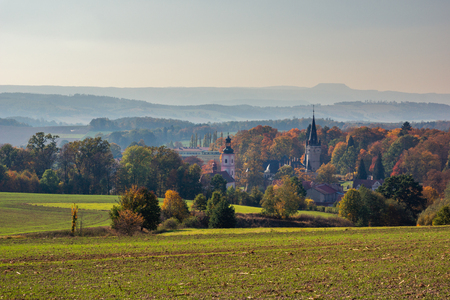 Palace and church in Bozkow near Stolowe mountains at autumn, Lower Silesia, Poland
