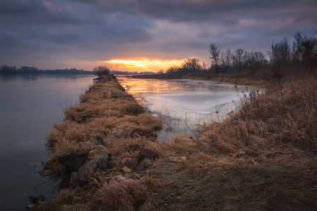 Sunrise over the causeway on the Vistula River somewhere in Poland