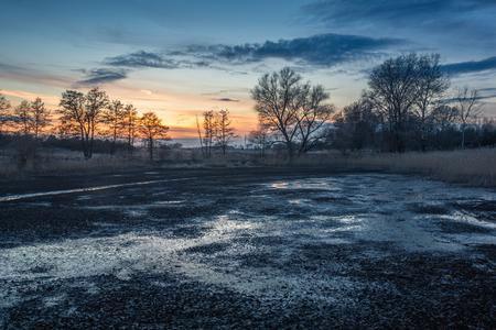 Dusk over the pond near Piaseczno, Masovia, Poland Imagens