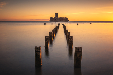 Sunrise over the ruins old military building on Baltic Sea in Babie Doly, Gdynia, Poland Stok Fotoğraf