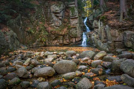 Podgorna Waterfall in the autumn scenery in Przesieka, Sudety, Poland