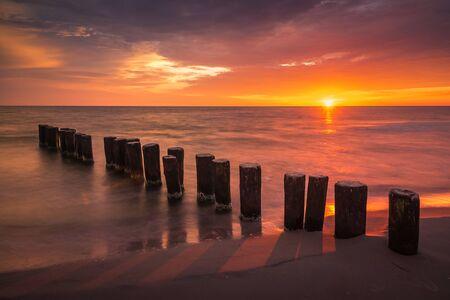 Sunrise over the breakwater on the Baltic sea, Poland Reklamní fotografie