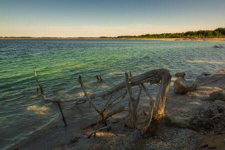 Azure lake called Osadnik Gajowka near Psary village, Poland