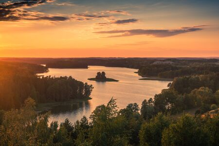 Sunset over the Jedzelewo lake in Stare Juchy, Masuria, Poland Stock Photo - 130068117