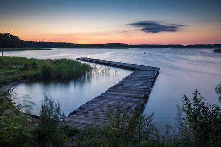 Footbridge on Lake Kirsajty during the sunset, Masuria, Poland