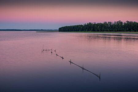 Fishing nets on Lake Dargin during the sunset, Masuria, Poland Stock Photo - 130068128