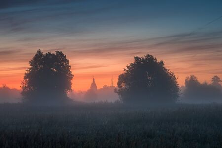 Foggy morning on a meadow near Piaseczno Stock Photo