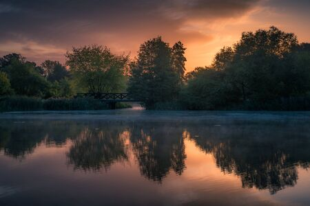 Dawn at the pond in Zalesie Dolne, Piaseczno, Poland Stock Photo - 130068214