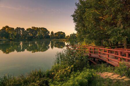 Bridge and pond in Zalesie Dolne, Piaseczno, Poland Stock Photo - 130068216