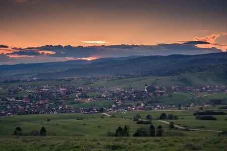 Dusk over the Kluszkowce village, Malopolskie, Poland Stock Photo - 130068222