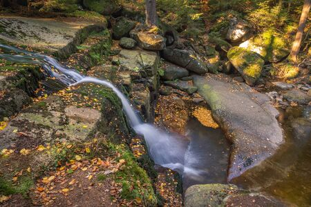 Waterfall Kaskady Myi in autumn in Sudety mountains, Przesieka, Poland