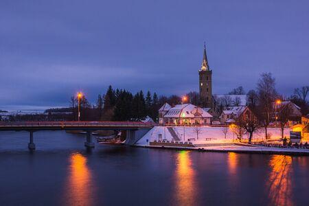 View on the church and lake in Mikolajki, Masuria, Poland
