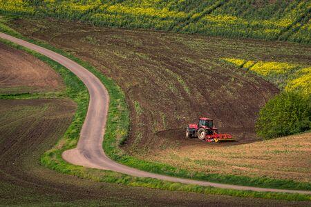Tractor in the moravian field at spring near Karlin, Chech Republic 版權商用圖片