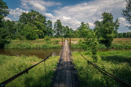 Wooden bridge over the Liwiec river at sunny day Korytnica, Masovia, Poland
