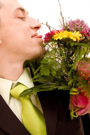 Man with flowers on white background Stock Photo - 4632004
