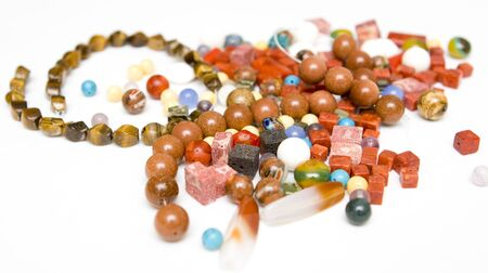 colorful beads: Jewellery making on a white background