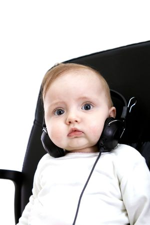 Baby with headphones on white photo