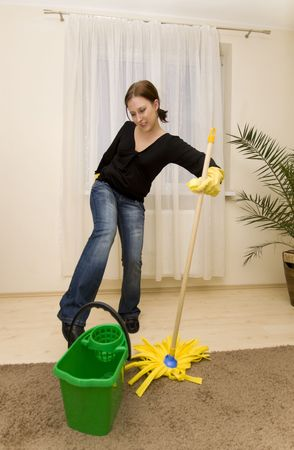 Woman cleaning house in gloves photo