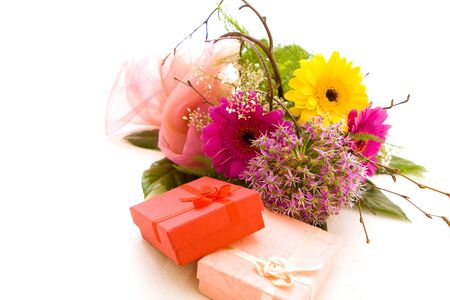 Flowers and present on white photo