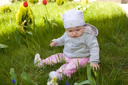 Sweet baby girl on grass Stock Photo - 5066300