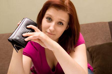 empty wallet: Sad woman with empty wallet