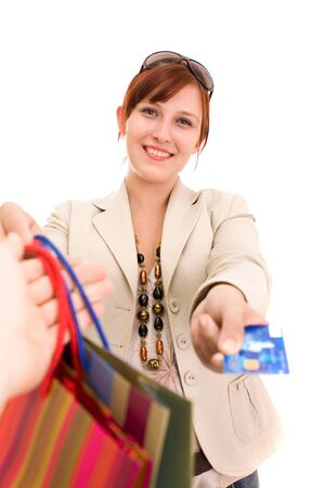 Young brunette woman paying for shopping Stock Photo - 5104778