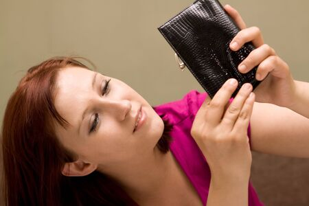 Sad woman with empty wallet photo