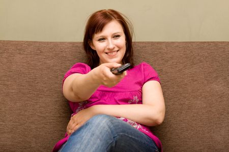 Happy woman with remote control  photo