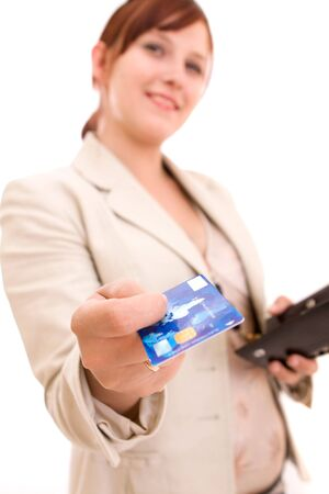 Young brunette woman paying for shopping photo