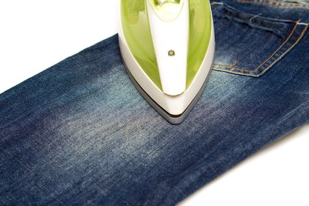 baclground: Ironing jeans on a white baclground