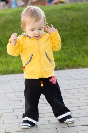 Sweet baby girl walking outdoor photo
