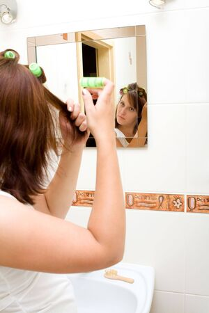 Woman in the mirror drying hair Stock Photo - 5494024