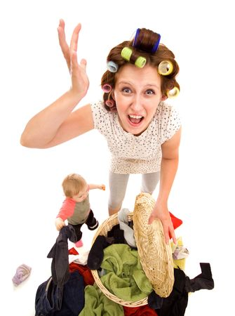 Angry housewife with a lot of washing photo