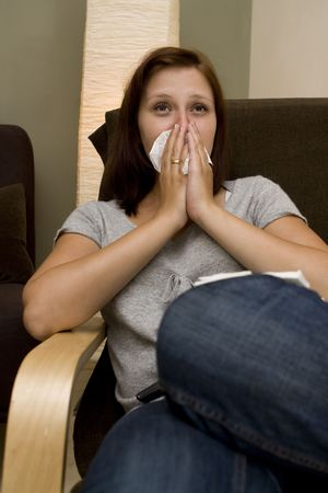 Sick women with a lot of tissues photo